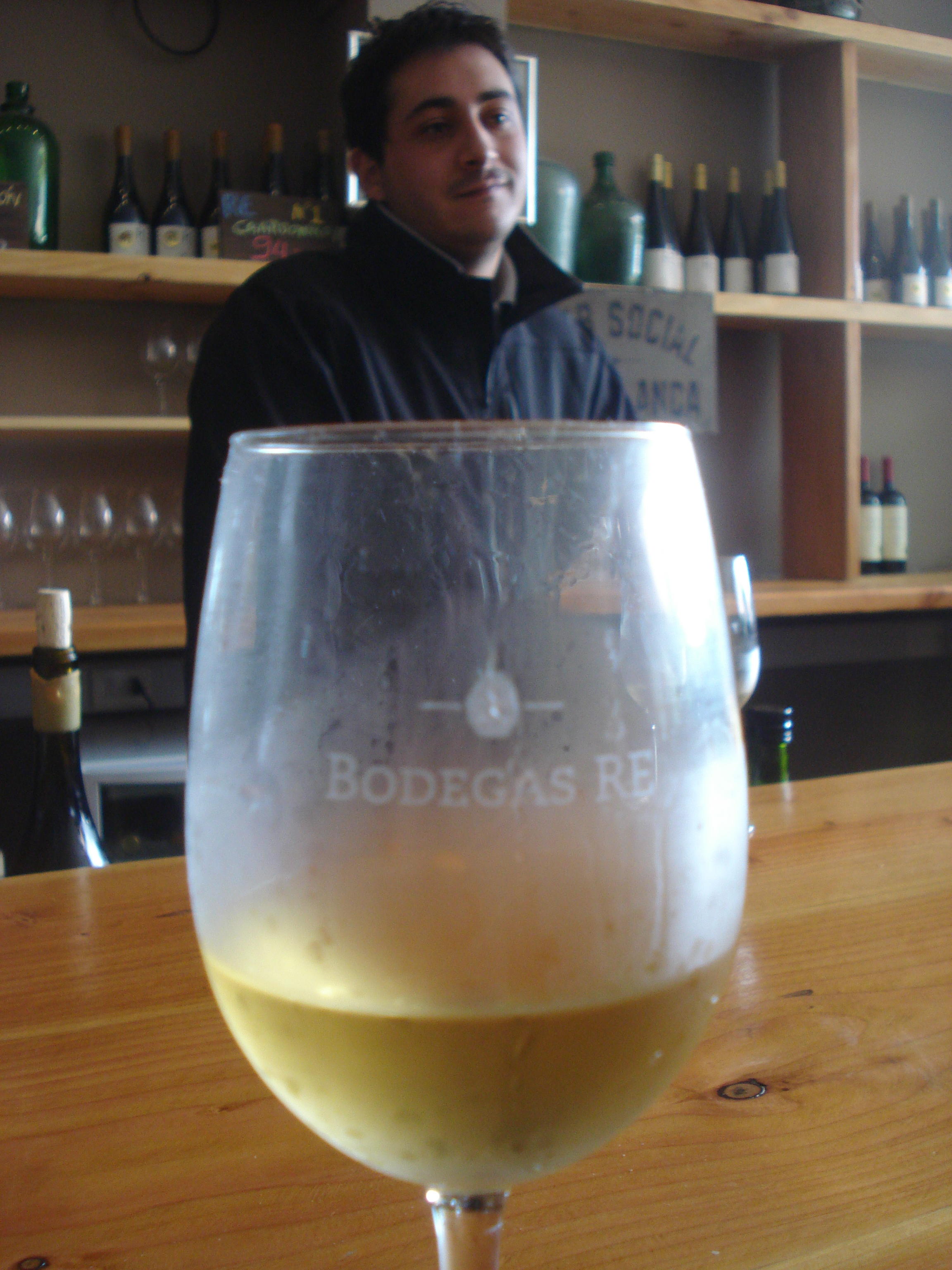 Rodrigo Gómez at Bodegas RE with a glass of their white pinot noir.