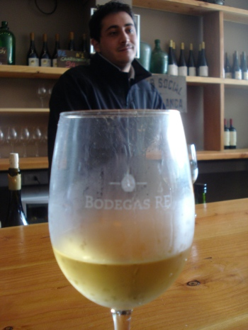 Rodrigo at Bodegas RE with a glass of their white pinot noir.
