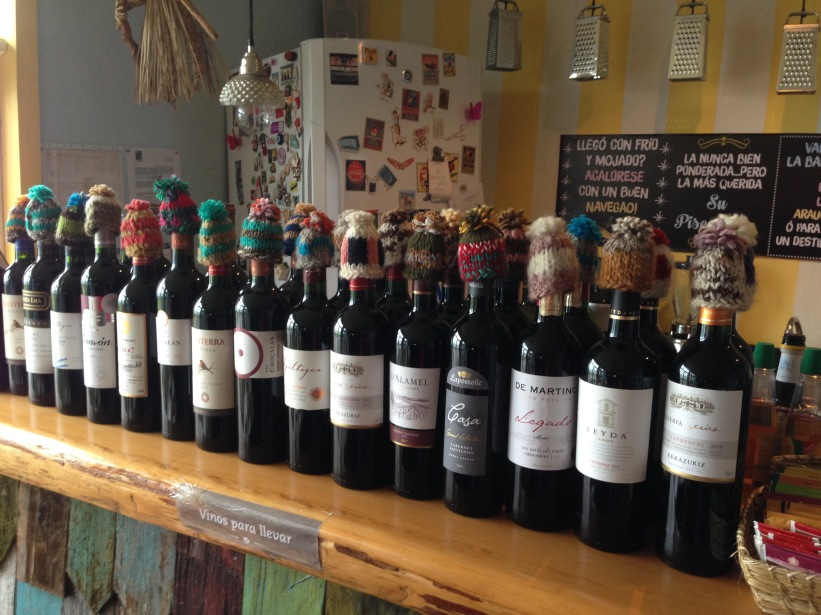 Woolen caps add a touch of quirky flair to wine bottles in Chiloé.