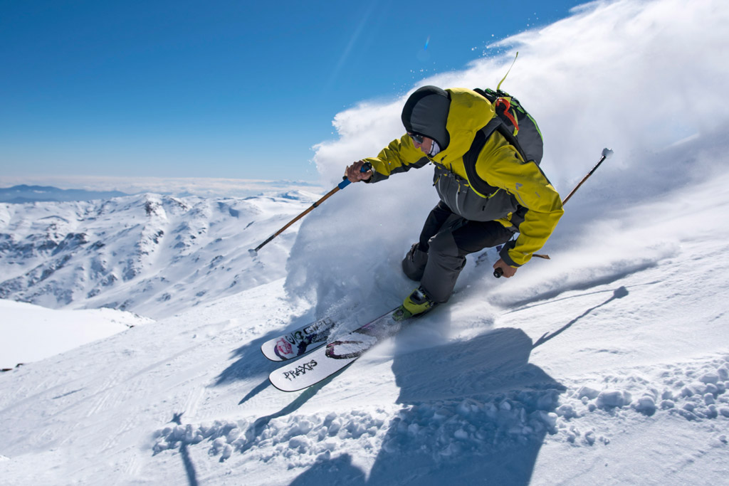 A skier makes a turn on top of the world at Ski Arpa. Photo by Michael Neumann, courtesy of Upscape Travel.