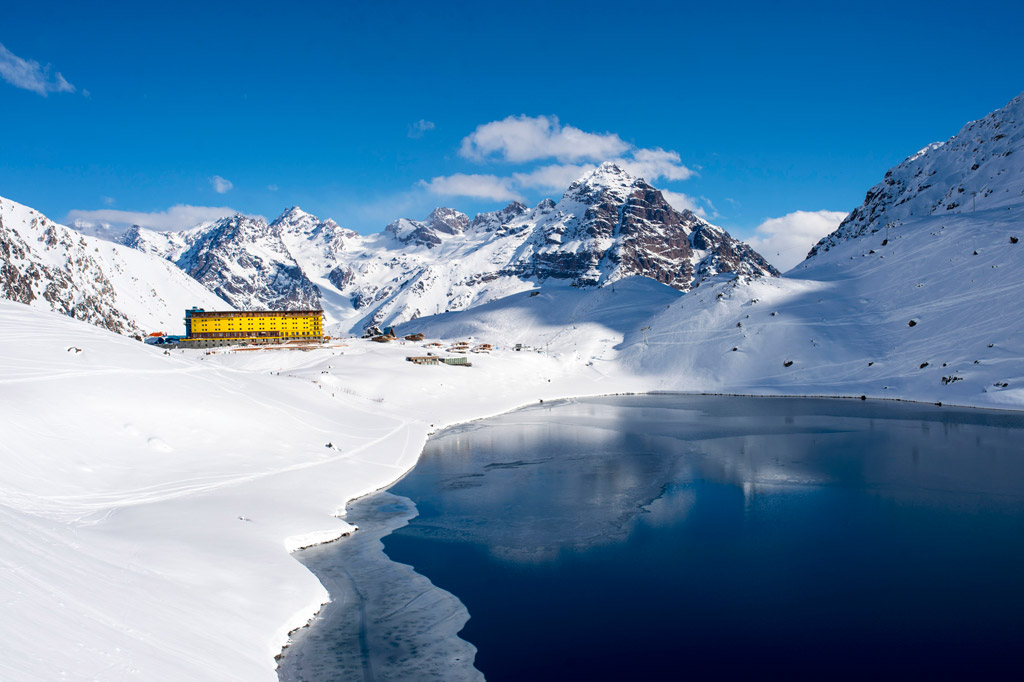 Hotel Portillo stands out against the dramatic Andes and Laguna del Inca. Photo courtesy of Ski Portillo.