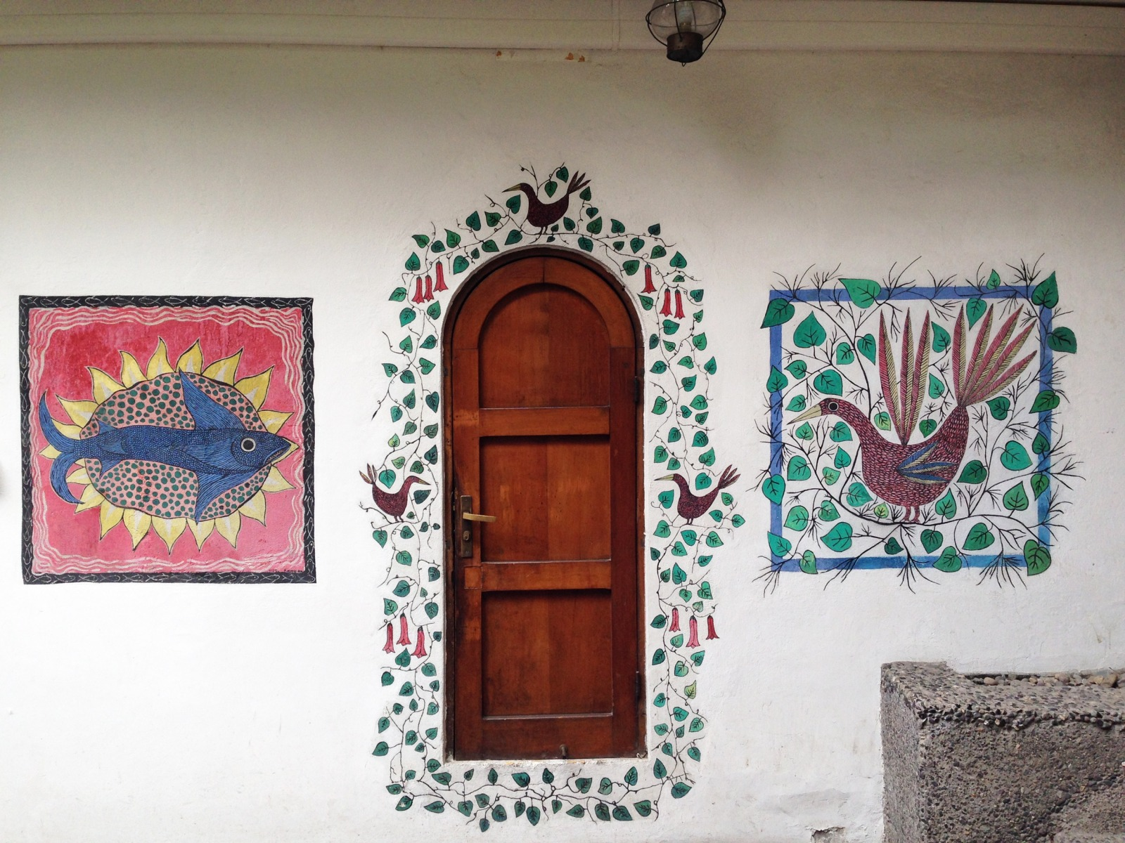 Wooden door between two animal paintings