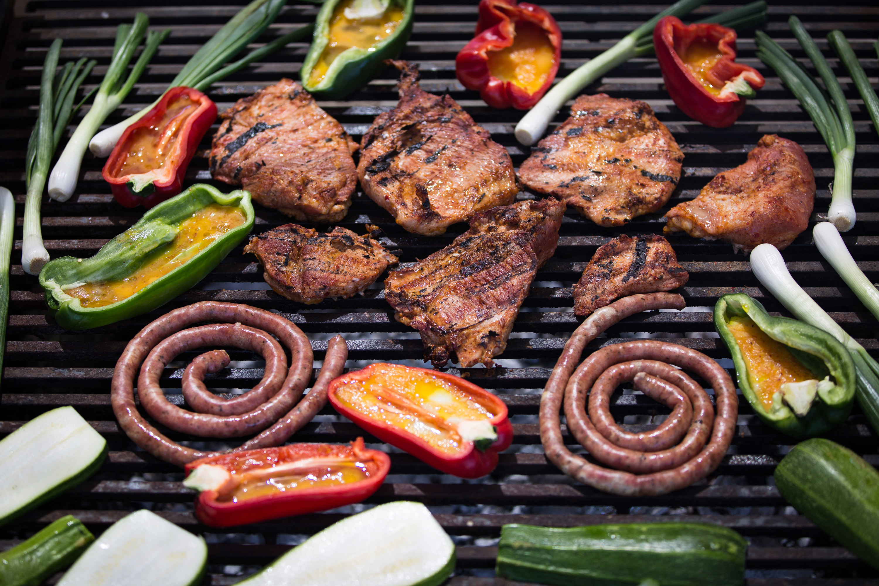 Meat and vegetables on the grill snapped by Nils Kingston during an asado at the winery.